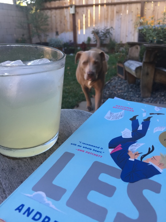 Backyard reading with a drink and a dog